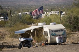 campsite at rtr 2108 with trailer, motorcycle and american flag